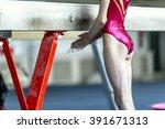 young girl gymnast preparing... | Shutterstock . vector #391671313