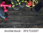 sport fitness items on dark... | Shutterstock . vector #391723207