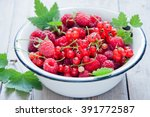 raspberry and red currant in... | Shutterstock . vector #391772587