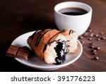 croissant with chocolate and... | Shutterstock . vector #391776223