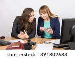 two young office employee... | Shutterstock . vector #391802683