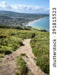 Small photo of Bray, Ireland - June 08, 2015: Pathway down to Irish seaside resort Bray from top of Bray Head mountain