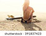 Beautiful Surfer Girl Sitting...