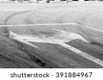 Small photo of bidirectional arrow symbol on a wet asphalt road for the concept of choice.
