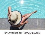 beautiful woman sunbathing by... | Shutterstock . vector #392016283