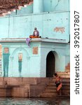 Small photo of Indian monk meditating on the roof of the building and local resident washable in the river Ganges, filmed in the city varansi India in November 2009