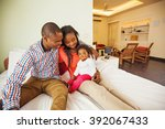 adorable african family at home ... | Shutterstock . vector #392067433