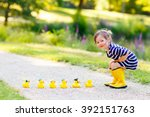 Stock photo adorable little kid girl playing in forest playground with yellow rubber ducks cute child wearing 392151763