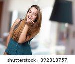 young cute woman sending a kiss | Shutterstock . vector #392313757