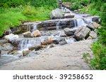 a roadside waterfall in glacier ... | Shutterstock . vector #39258652