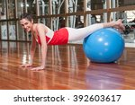 woman stretching with a ball | Shutterstock . vector #392603617