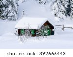 small chalet in the snow of the ... | Shutterstock . vector #392666443