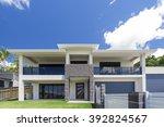 modern home exterior on a sunny ... | Shutterstock . vector #392824567