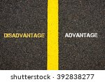 Small photo of Antonym concept of DISADVANTAGE versus ADVANTAGE written over tarmac, road marking yellow paint separating line between words