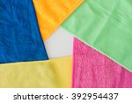 Small photo of Five overlapping microfiber cleaning clothes of different colors forming a pentagon