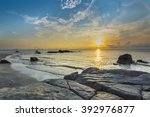 beach rock and wave with... | Shutterstock . vector #392976877