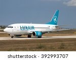 """Small photo of Luqa, Malta July 14, 2004: Luxair Boeing 737-5C9 on taxiway """"Charlie"""" awaiting clearance to backtrack runway 32 for take off."""