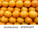 Closeup Of Many Oranges On A...