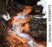 Among Orange Rocks Running Water