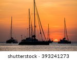 Silhouette Of Sail Boat On Sea...