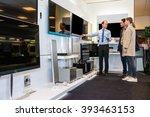 salesman showing flat screen tv ... | Shutterstock . vector #393463153