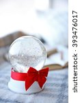 snow globe with red bow beside... | Shutterstock . vector #393476017