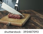 knife cut slice of grilled meat ...   Shutterstock . vector #393487093