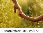 a the parent holds the hand of... | Shutterstock . vector #393590677