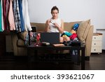 young hipster woman sorting her ... | Shutterstock . vector #393621067