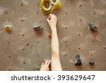 young man climbing indoor | Shutterstock . vector #393629647