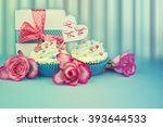 cupcakes with roses and gift... | Shutterstock . vector #393644533
