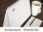 desktop calendar sitting on... | Shutterstock . vector #393646783
