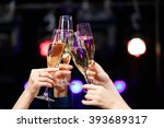 clinking glasses of champagne... | Shutterstock . vector #393689317