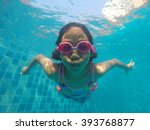 the little girl in the water... | Shutterstock . vector #393768877