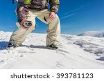Small photo of a man filming with action camera in snowy mountain range
