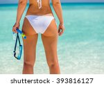 back of young woman in bikini... | Shutterstock . vector #393816127