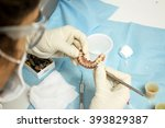 girl working on dental clinic | Shutterstock . vector #393829387