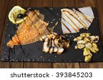 delicious smoked salmon fish... | Shutterstock . vector #393845203