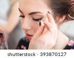 closeup of makeup artist doing... | Shutterstock . vector #393870127