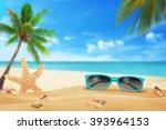 sun glasses on beach. starfish... | Shutterstock . vector #393964153