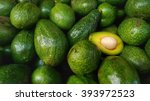 Bunch Of Green Avocados. One O...