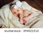 a newborn baby in the basket. a ... | Shutterstock . vector #394021513