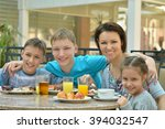 mother and children  at... | Shutterstock . vector #394032547