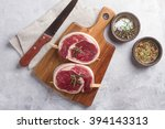 thick raw beef with seasoning... | Shutterstock . vector #394143313