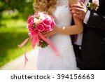 bride and groom holding wedding ... | Shutterstock . vector #394156663