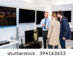 salesman showing flat screen... | Shutterstock . vector #394163653