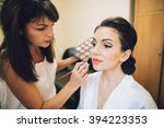 wedding makeup artist making a... | Shutterstock . vector #394223353