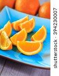 fresh slices of orange served... | Shutterstock . vector #394230007