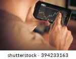 a man checking stock market on... | Shutterstock . vector #394233163