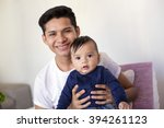 young mexican father takes care ... | Shutterstock . vector #394261123